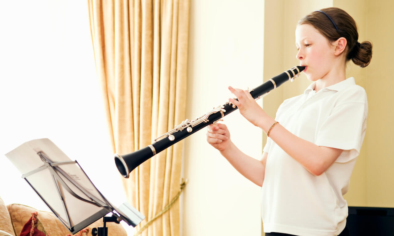 Young girl (10-12 years old) playing the clarinet