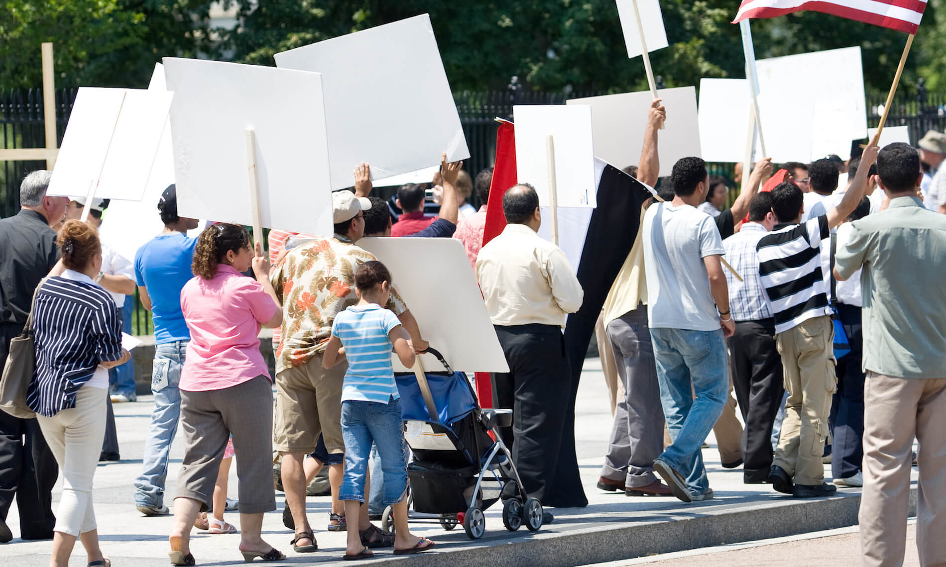 A group of peaceful protestors with banners and posters