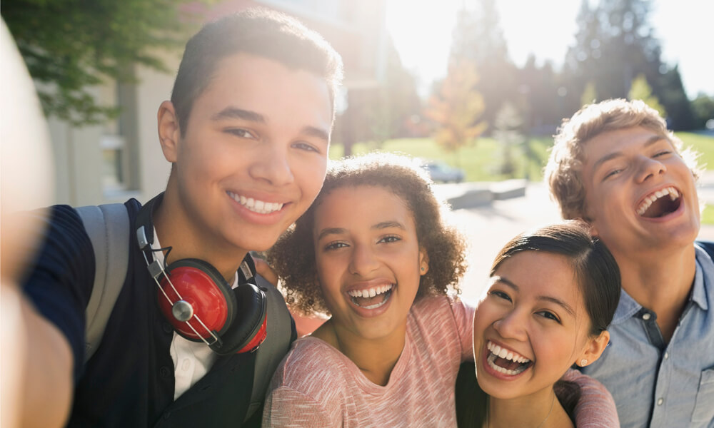 Selfie photo of students outdoors