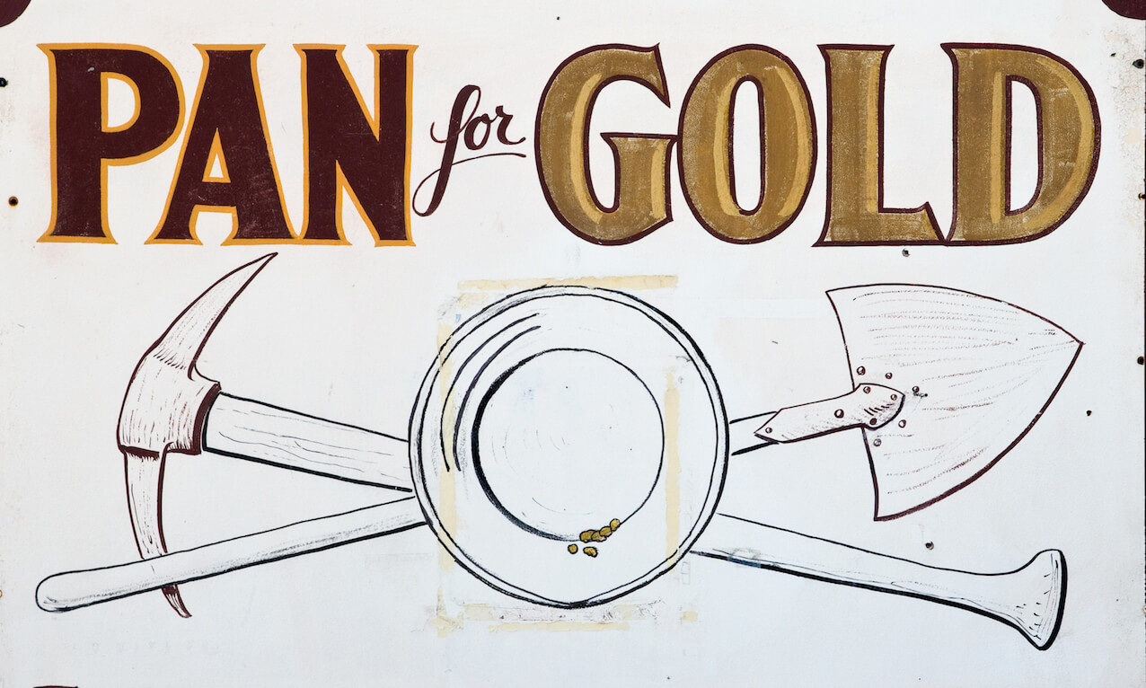 Vintage sign advertising gold panning