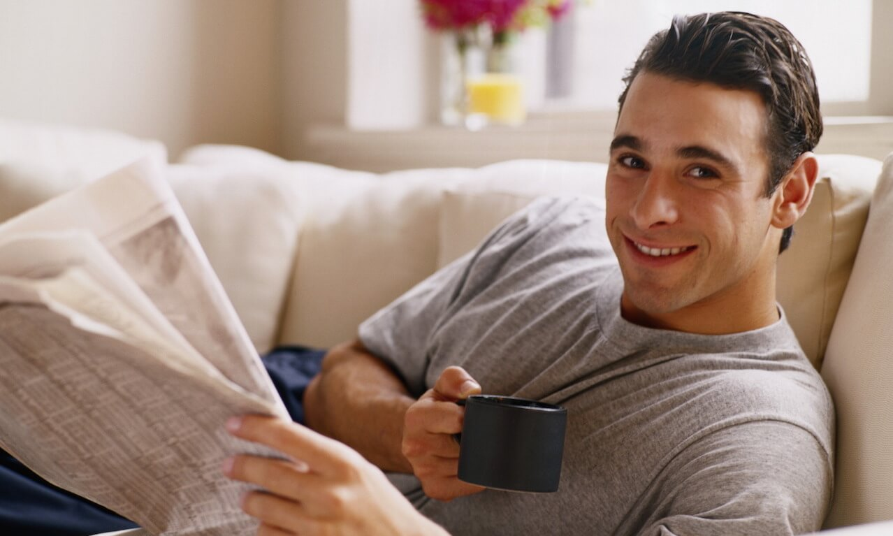Man with Coffee and a Newspaper