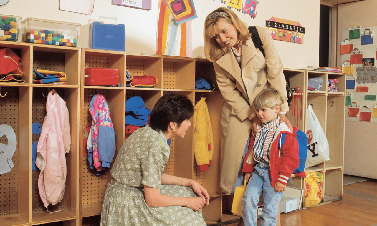 Mother and son in classroom meeting new teacher