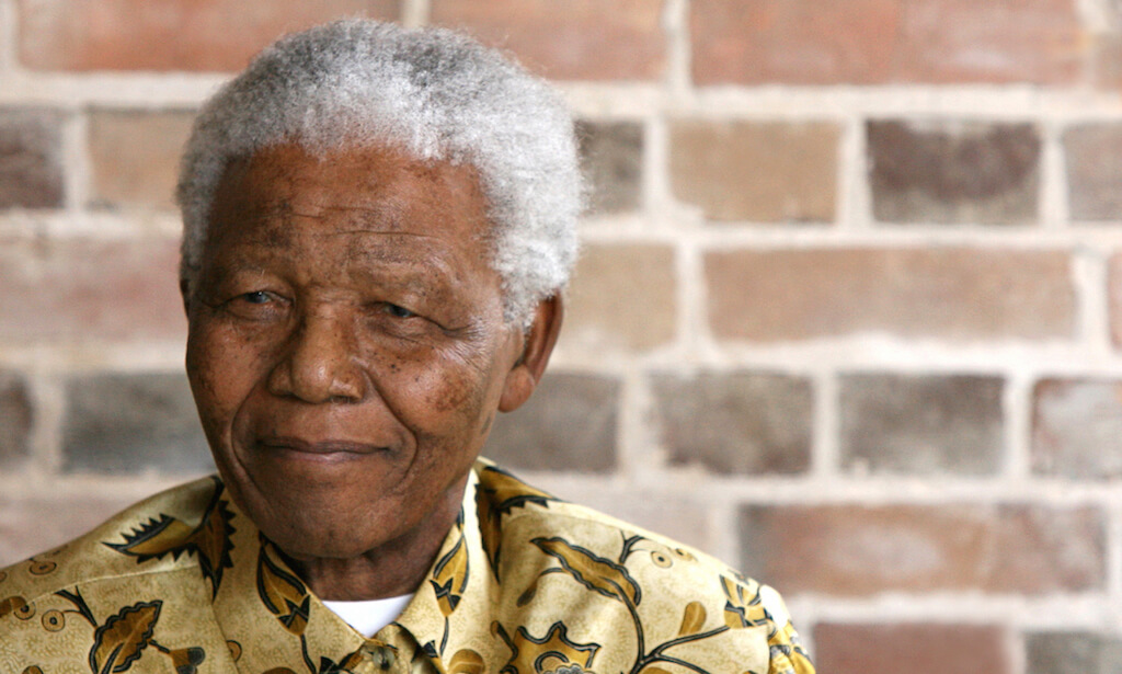 Late South African president Nelson Mandela looks on as he poses for a portrait during an event in London on May 24, 2006