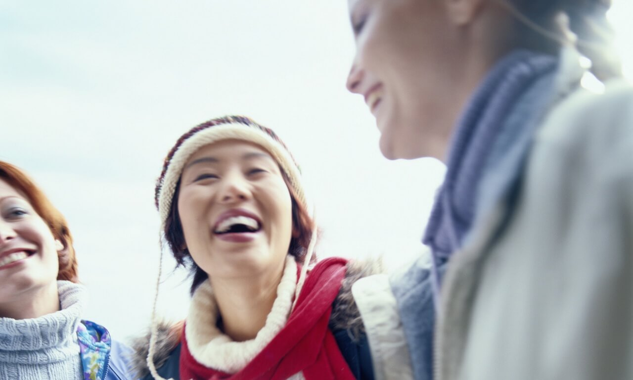 Young Women in Casual Winter Clothing, Laughing