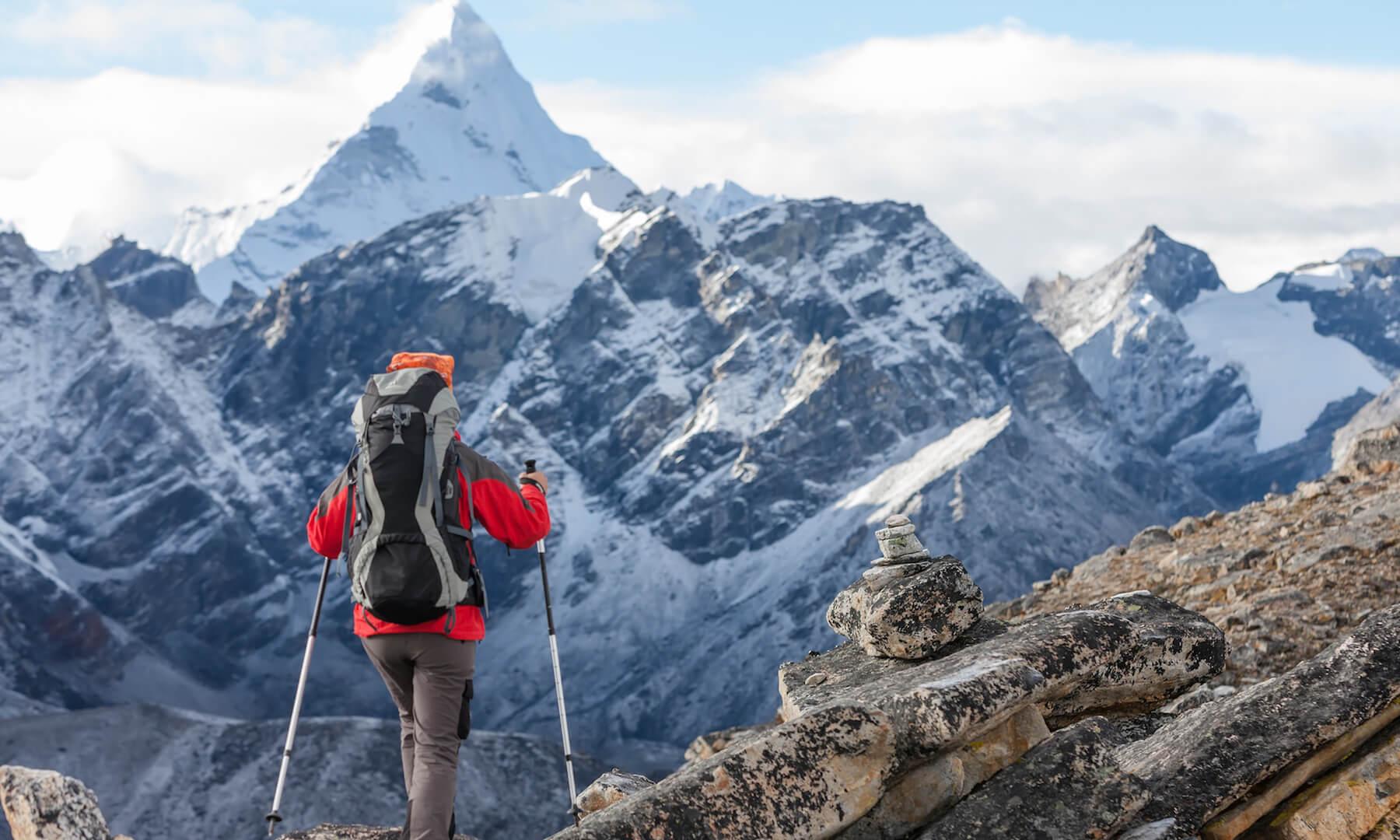 Hiker walks on trail in Himalayas