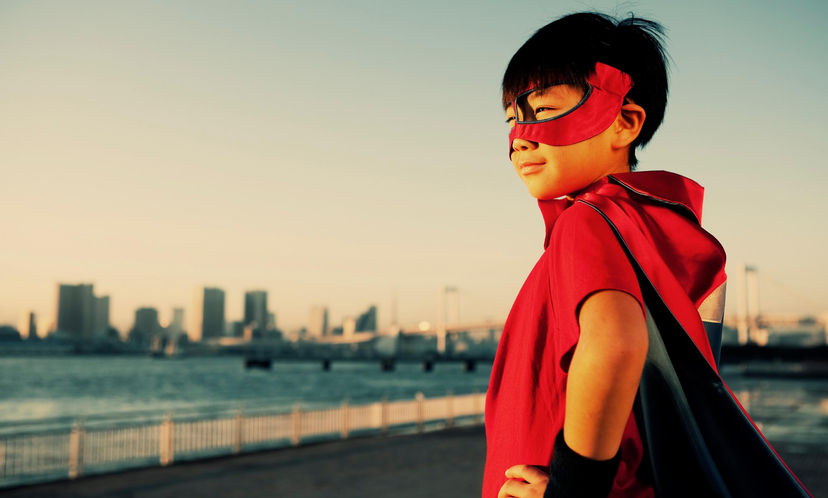 Portrait of a young Japanese boy superhero.