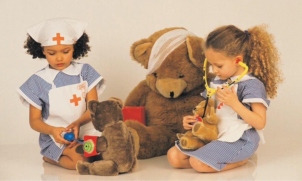 Girls dressed in identical nurse costumes playing together