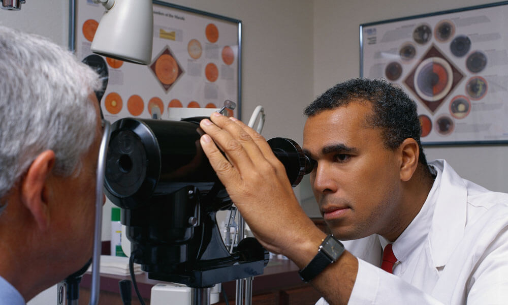 Eye Doctor Examining Patient's Eyes