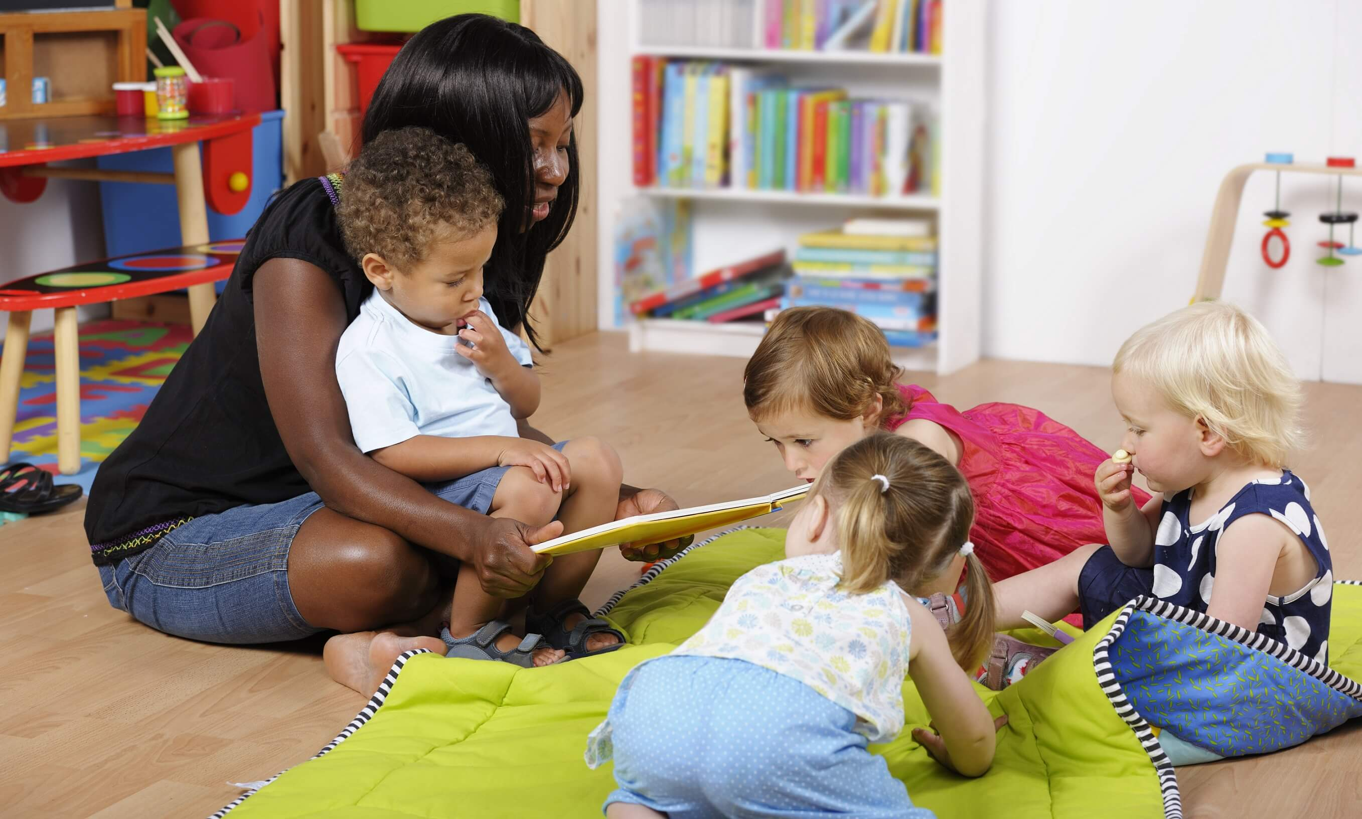 Woman reading to toddlers