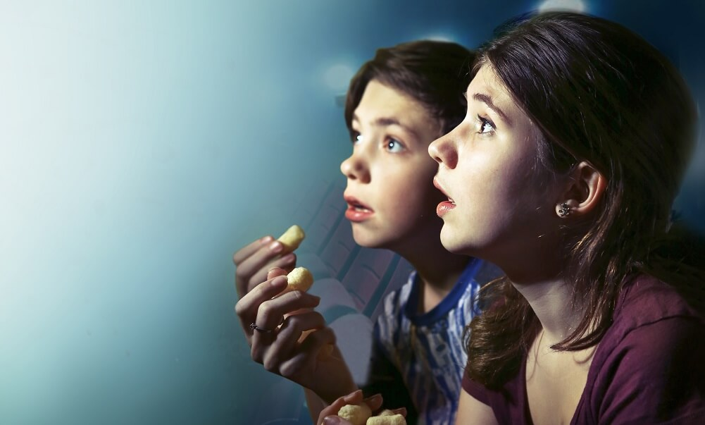 Teens watching a horror movie