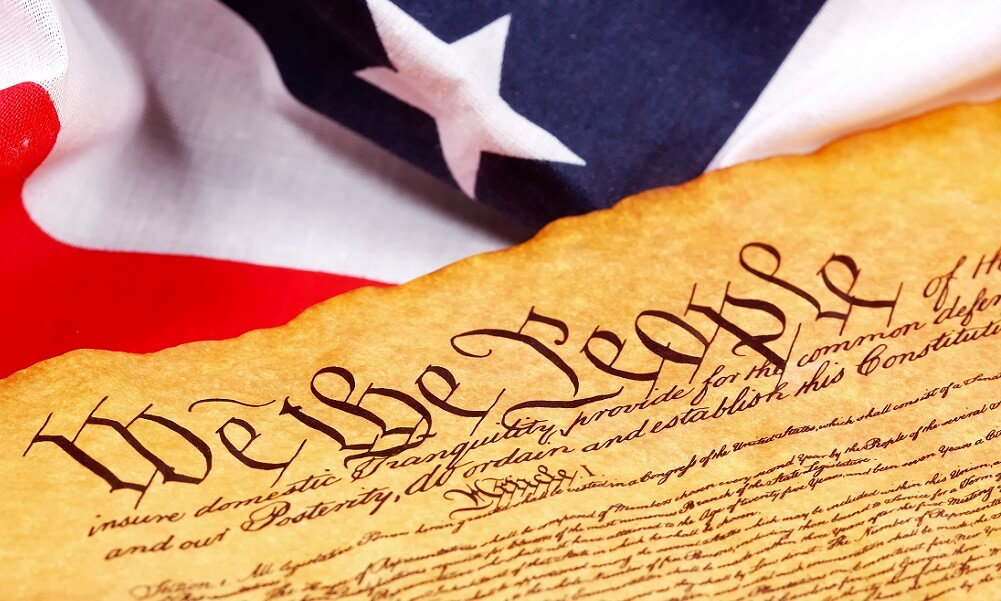 Constitution of the United States and American flag