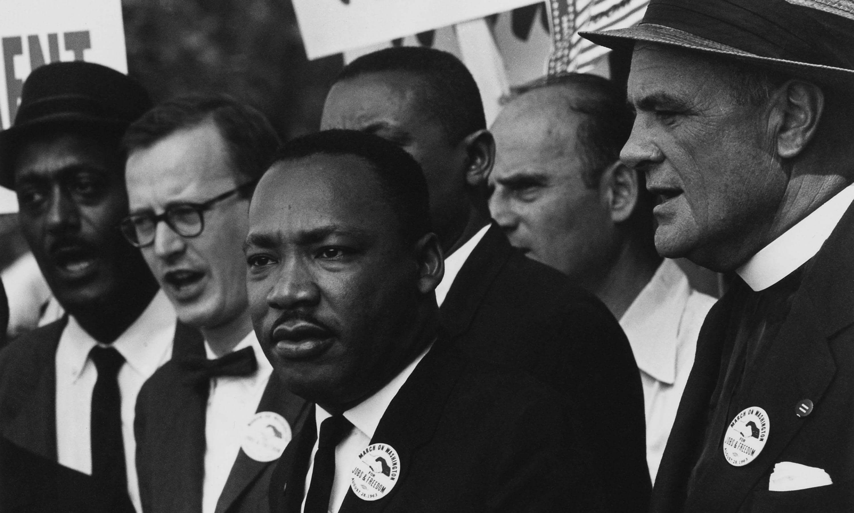 Martin Luther King and other leaders of the March singing on the steps of the Lincoln Memorial