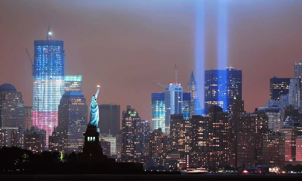 Manhattan skyline with two beams of light for September 11th tribute