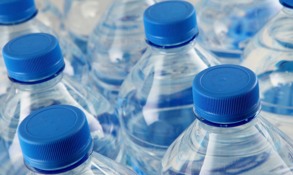 Water bottles with blue caps