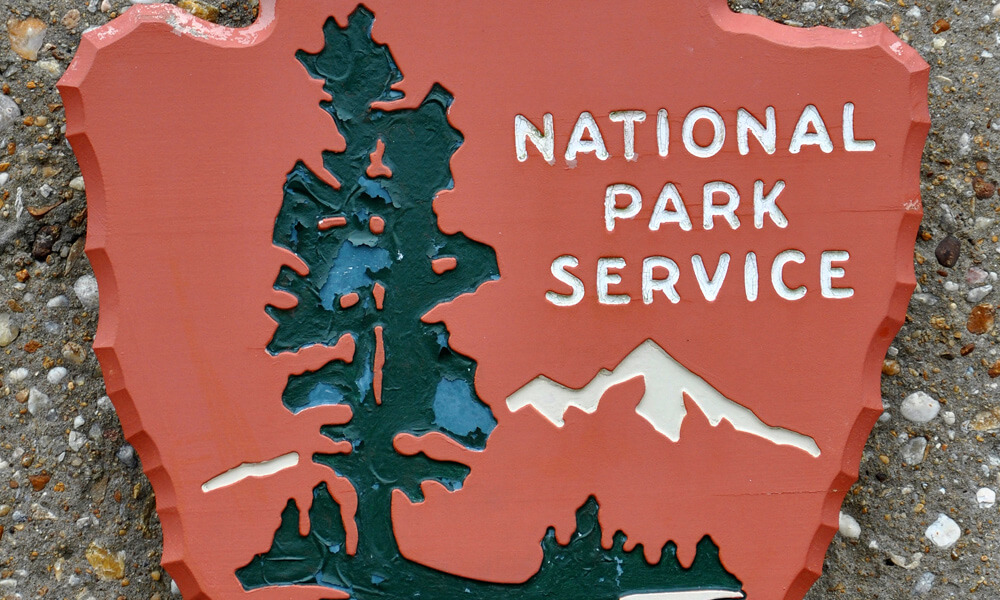 US national park service sign on rock background