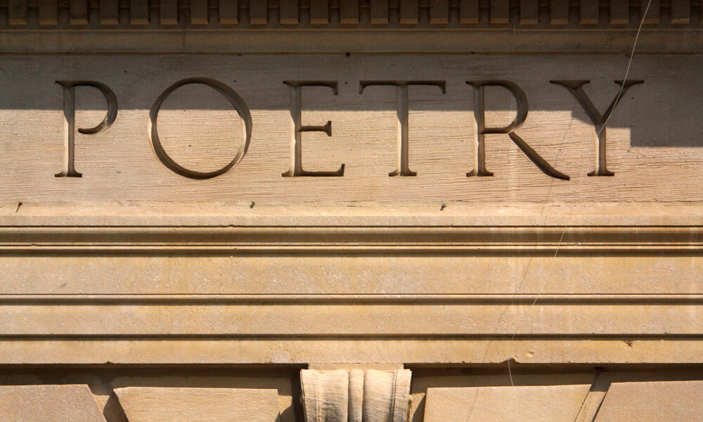 The word poetry inscribed on a building