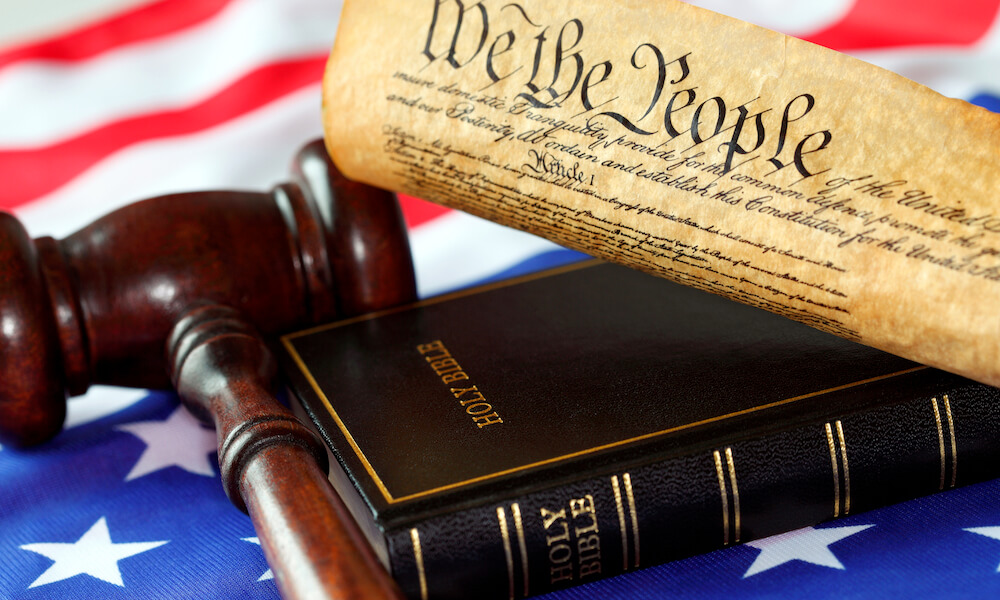 US Constitution, Bible, Flag and Gavel.