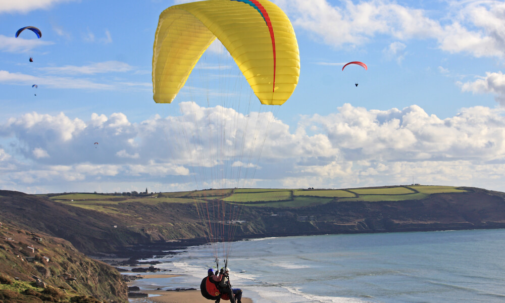 Paraglider above Whitsand Bay