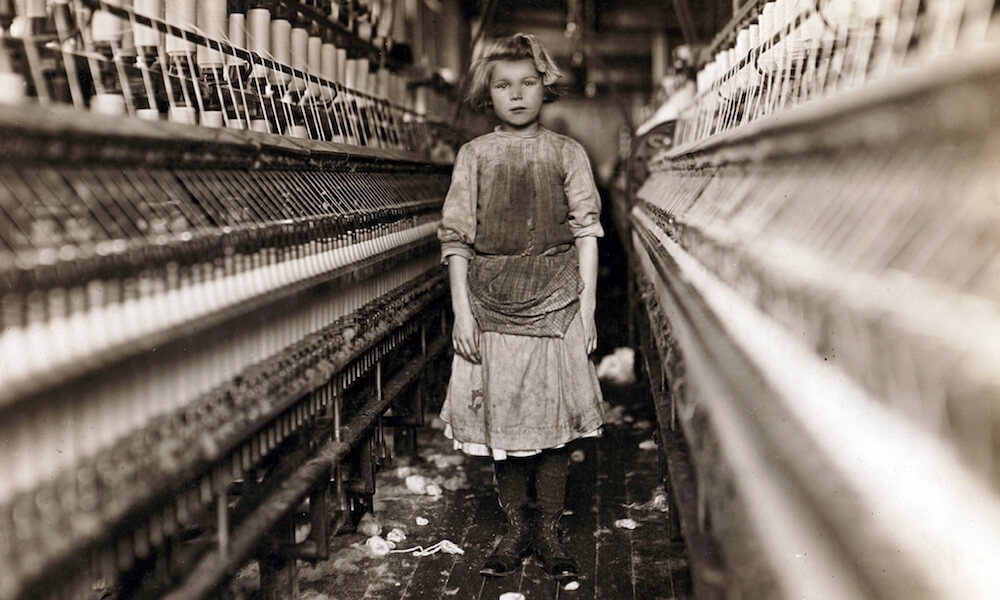 Child laborer portrayed by Lewis Hine in 1909. Little spinner who regularly worked in cotton mill in Augusta, Georgia.