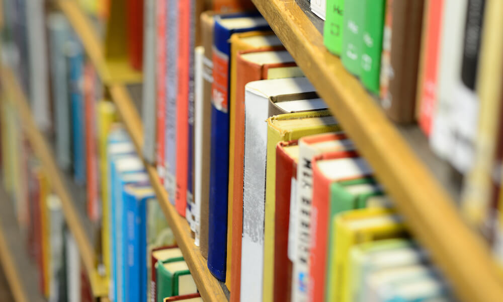 Books in shelf in library