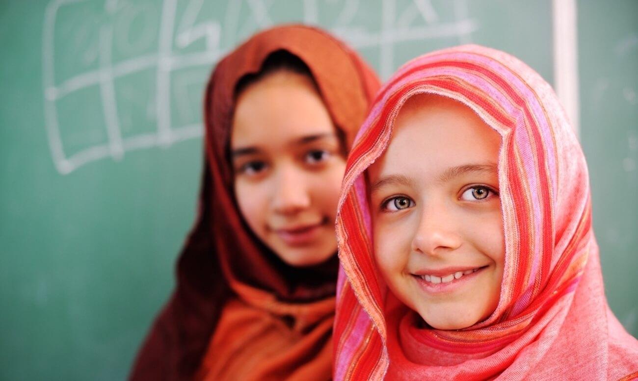 Arabic schoolgirls in classroom in front of a chalkboard
