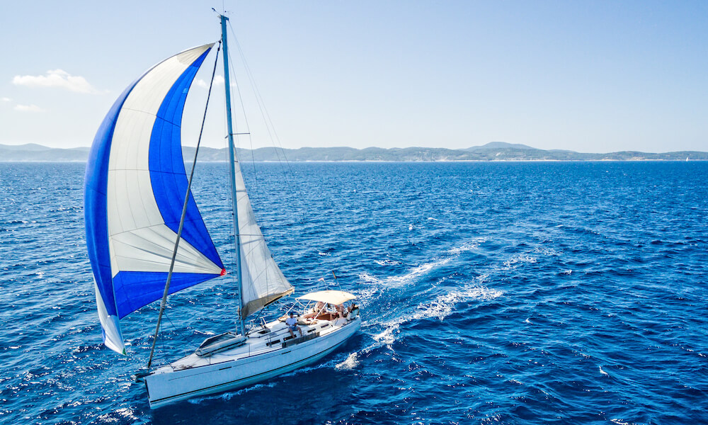 Sailboat during sailing. High angle view from quadcopter Phantom 3. Model released.