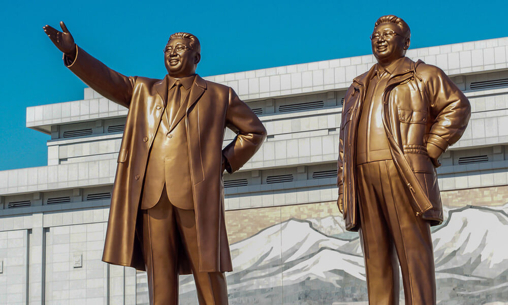 Statues of Kim Il Sung (left) and Kim Jong Il on Mansudae Monument at Pyongyang, North Korea.