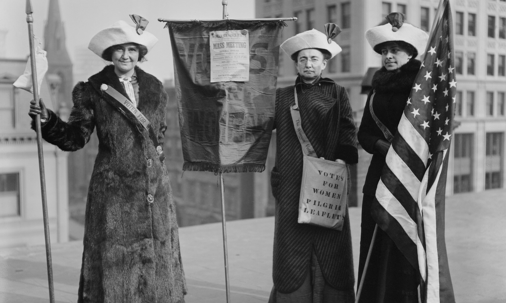 Three suffragettes demonstrate in New York City to promote Suffrage Hike of 1912 from Manhattan to Albany and distribute their VOTES FOR WOMEN PILGRIM leaflets.