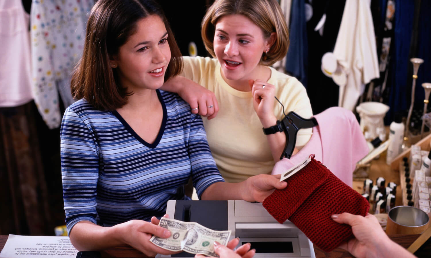 Teen girls (14-15 years old) buying clothing