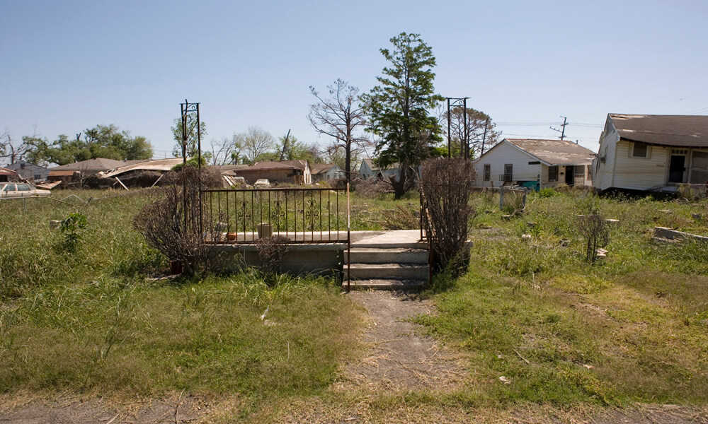 Concrete steps leading to an empty lot in the Ninth Ward of New Orleans after Hurricane Katrina