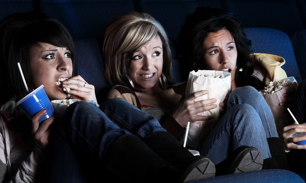 Audience watching a scary movie