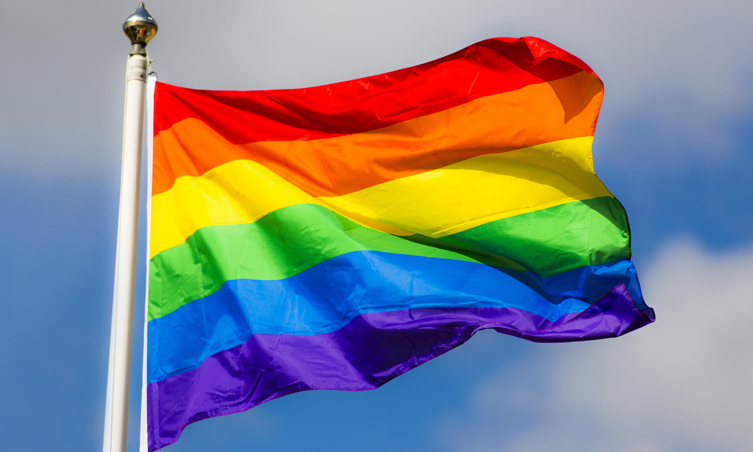 Rainbow flag waving in wind