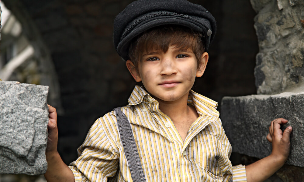 Boy portraying orphan Oliver Twist