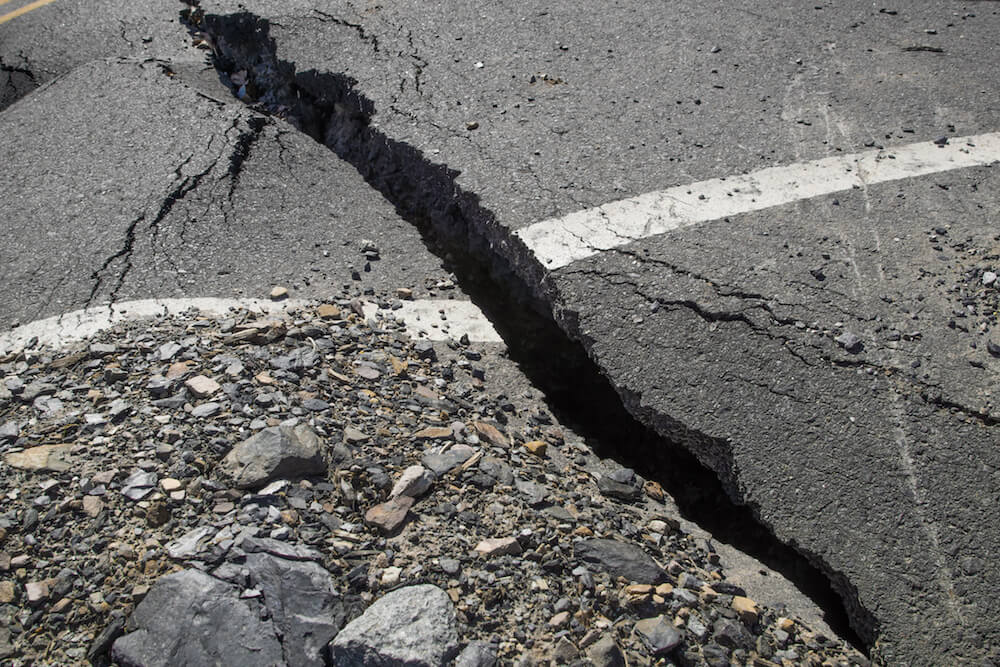 A crack in the pavement, the destruction of the road