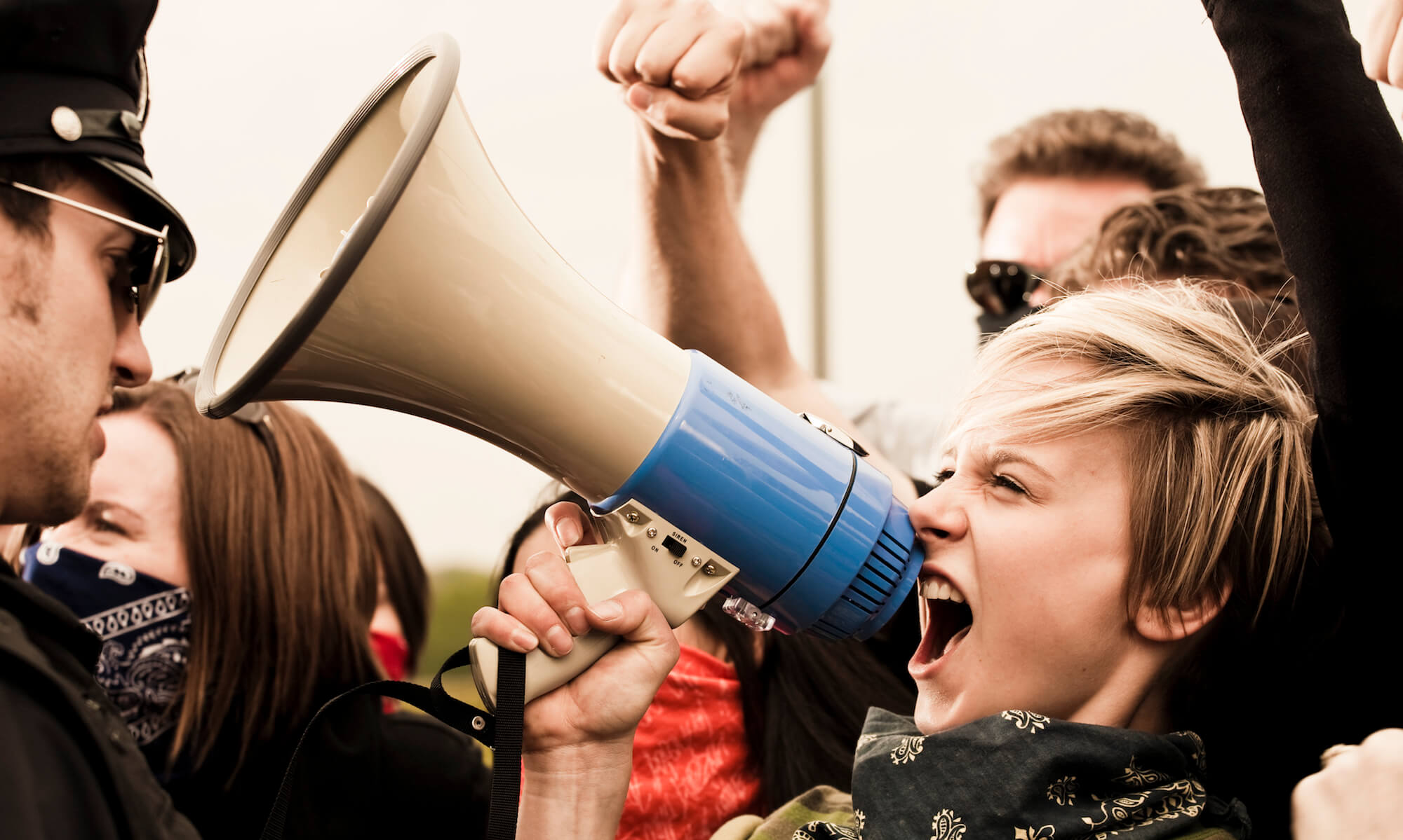 Woman yelling into megaphone at protest