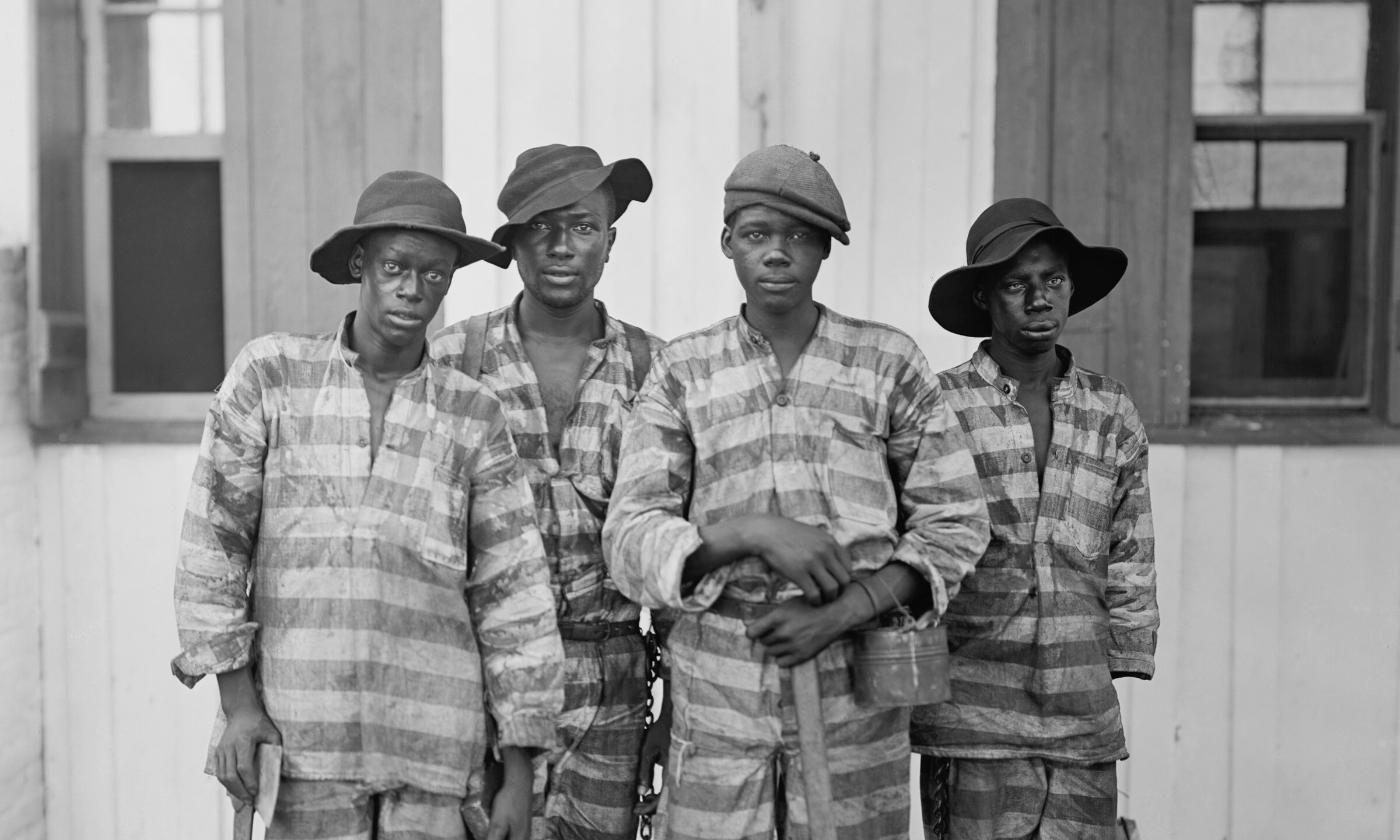 Four African American youths in a Southern chain gang. Southern jails made money leasing convicts for forced labor in the Jim Crow South. Circa. 1900