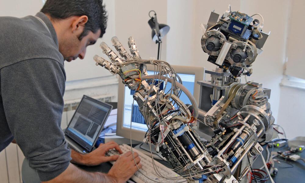 Man programming a robot
