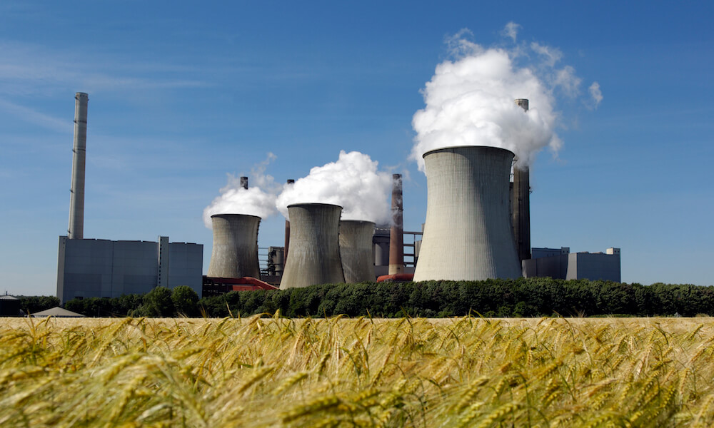 Coal burning power plant (Germany), a grain field in the foreground