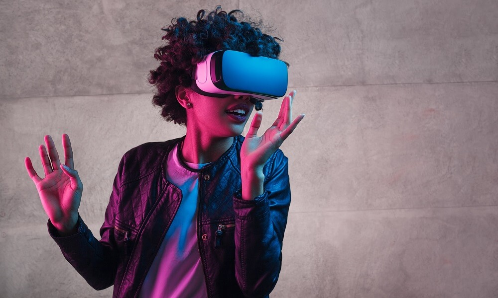 Teenager girl wearing virtual reality headset