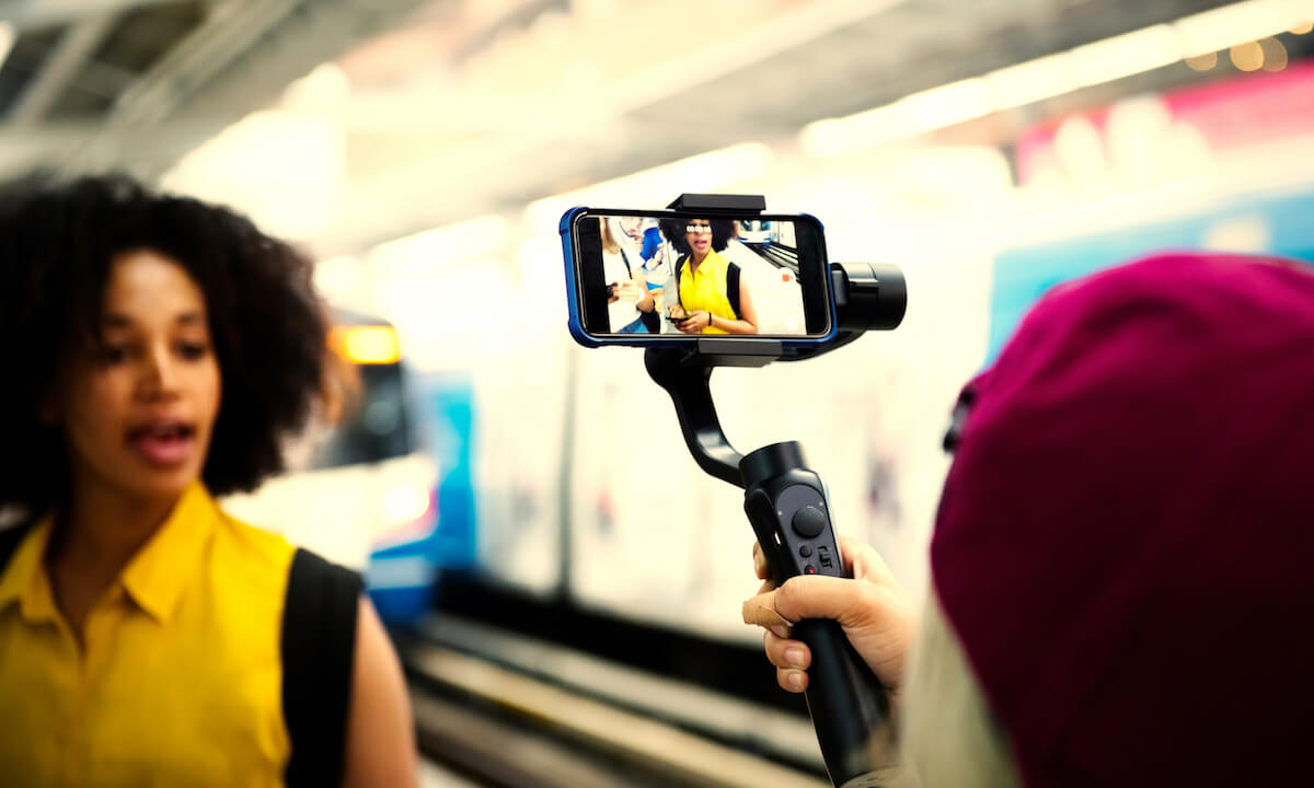 Young woman traveling and vlogging