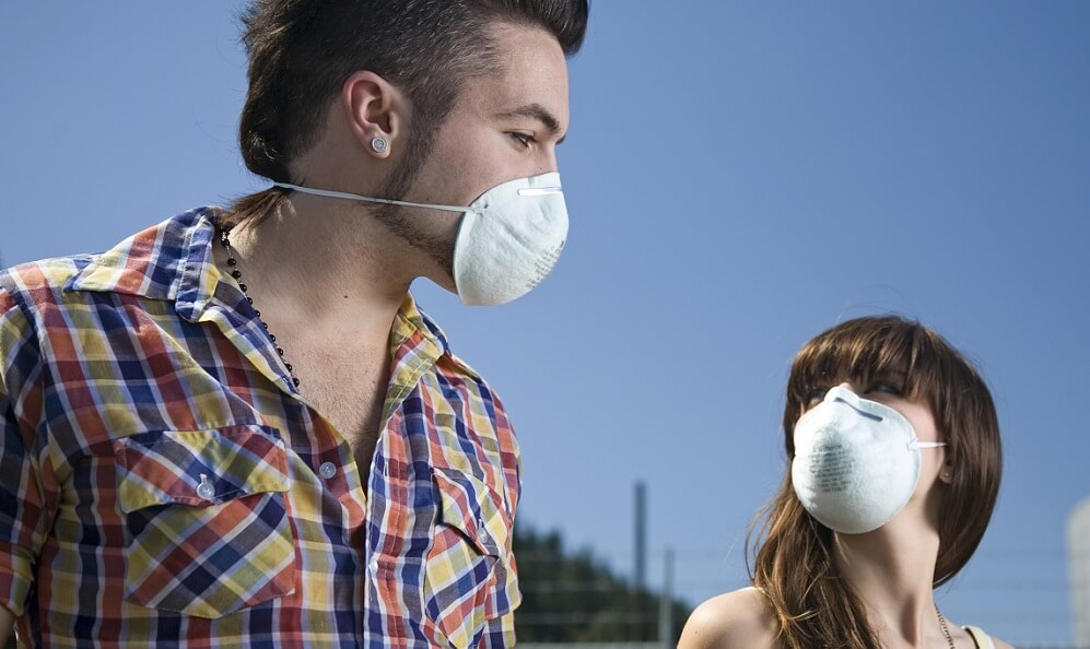 Young adults wearing protective masks