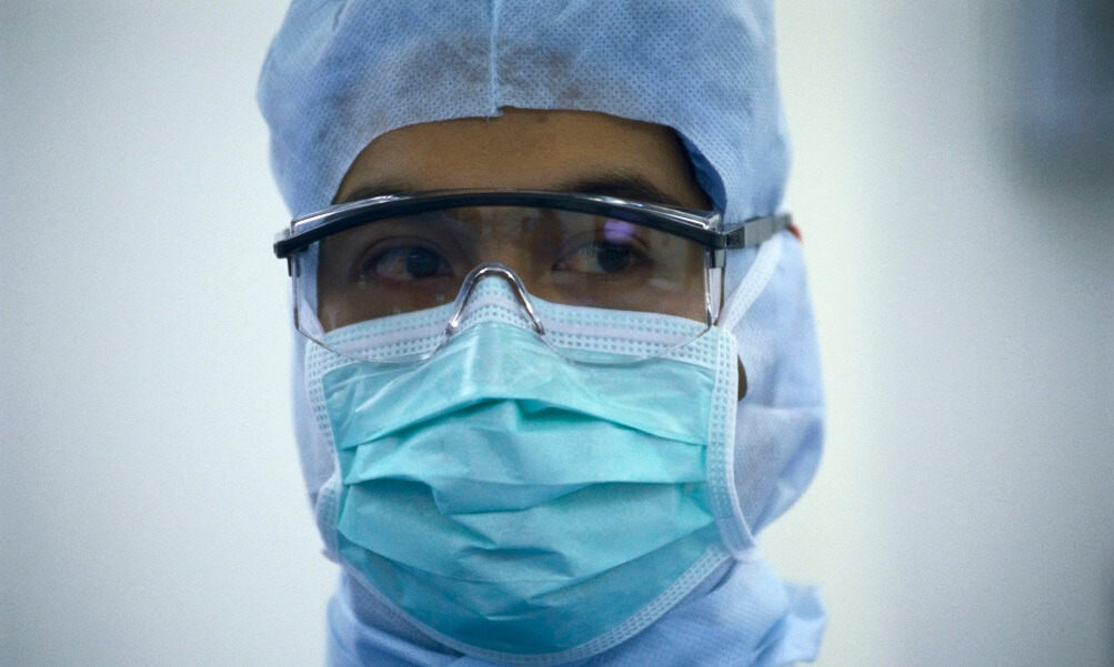 Doctor wearing goggles, mask, and head covering