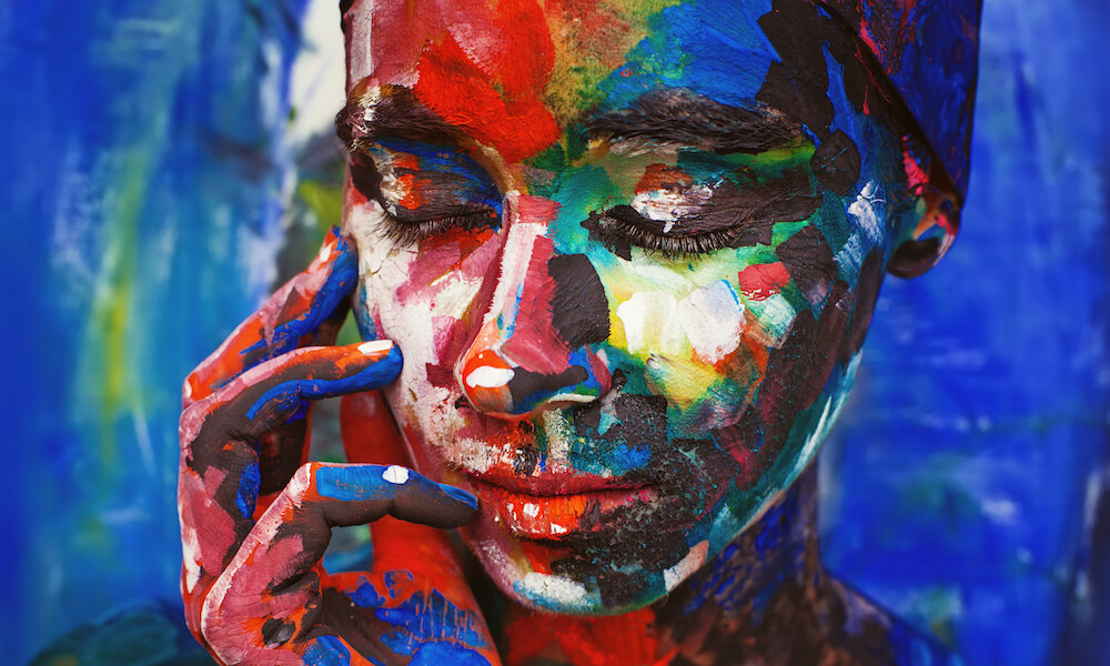 real woman painted upon her face imitating the oil painting