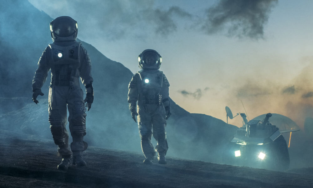 Two astronauts walking on an alien planet with a rover vehicle in the background