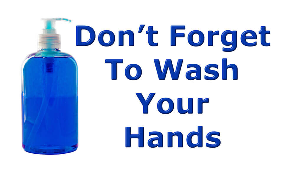 Don't forget to wash your hands message with a liquid soap dispenser on an isolated white background