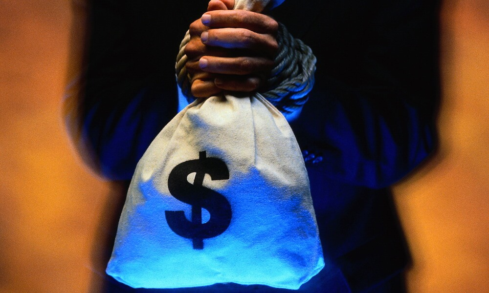 Businessman Tied to a Sack of Money