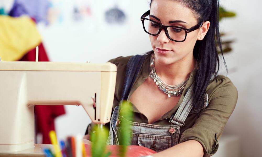 Designer working on sewing machine