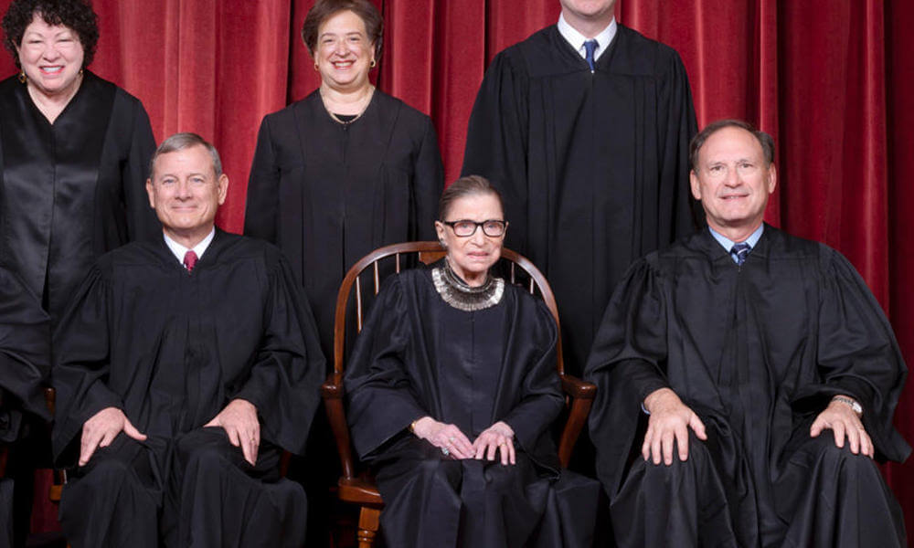The Supreme Court, November 30, 2018. Seated, from left to right: Justices Stephen G. Breyer and Clarence Thomas, Chief Justice John G. Roberts, Jr., and Justices Ruth Bader Ginsburg and Samuel A. Alito. Standing, from left to right: Justices Neil M. Gorsuch, Sonia Sotomayor, Elena Kagan, and Brett M. Kavanaugh.