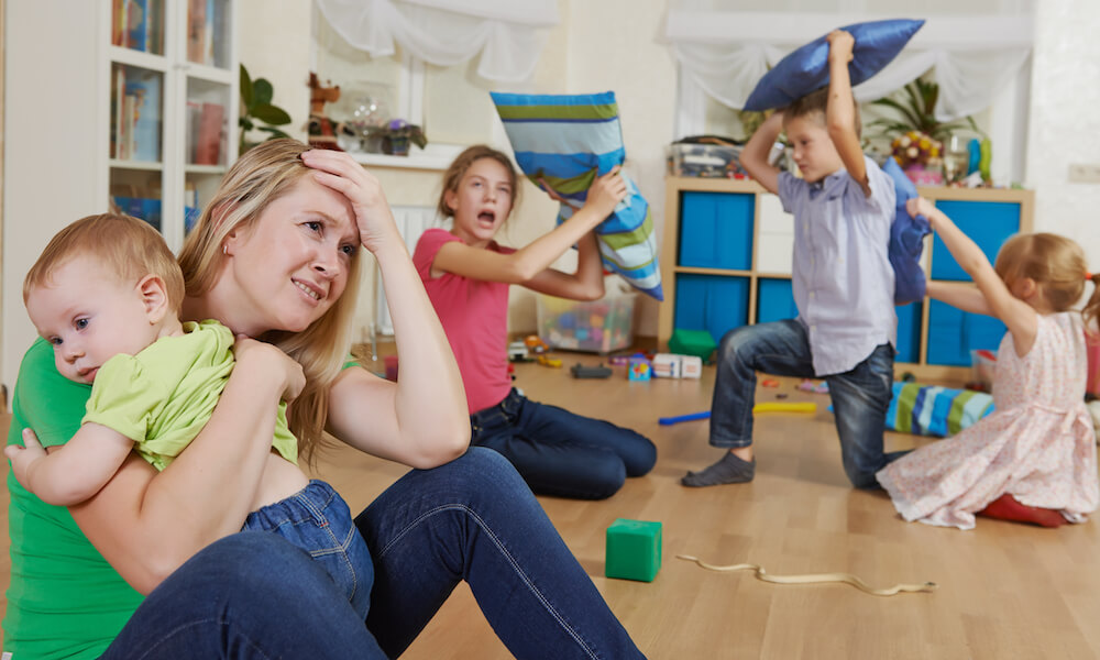 female parent woman frustrated and upset from children behavior