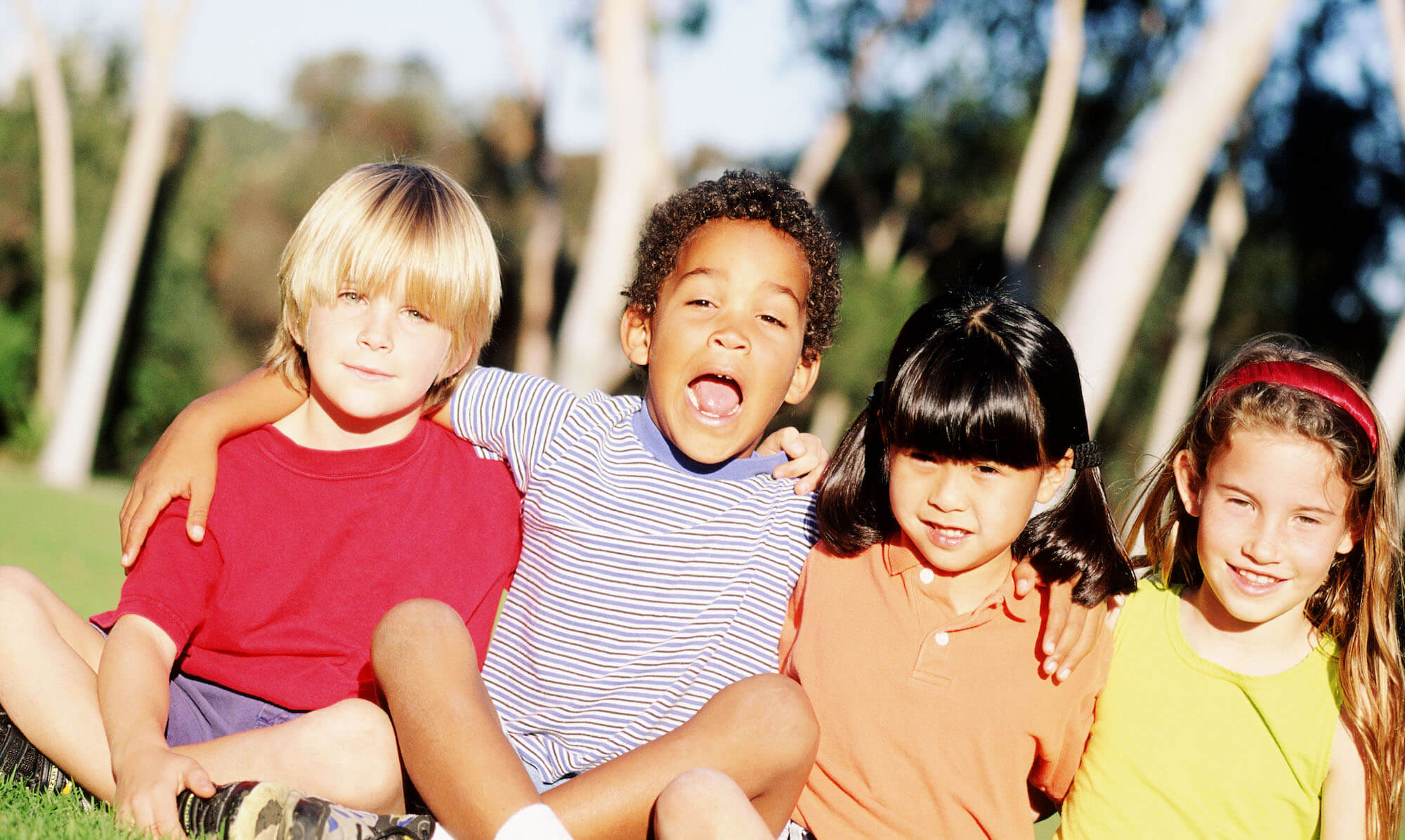 four children of different races playing together